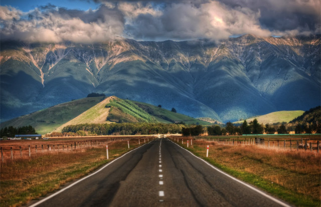 Long roads of New Zealand. No part of the country is more than 128km (79 miles) from the sea. Photo by: Trey Ratcliff