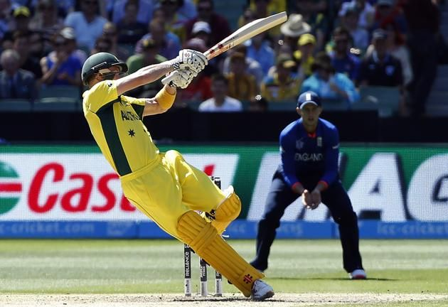 Australia's captain George Bailey falls over as he plays a shot during the Cricket World Cup match against England at the Melbourne Cricket Ground